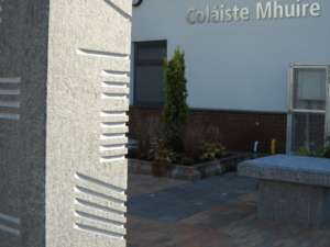 06 Flamed Limestone Ogham Stone and seating