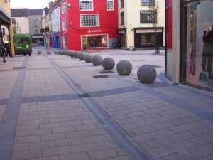 32 Limestone Paving, Channels, and circular Bollards